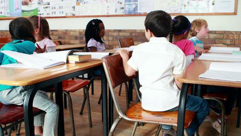 Little children talking in classroom Footage
