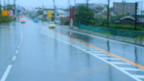 Bus Rides Down The Street In The Rain stock footage