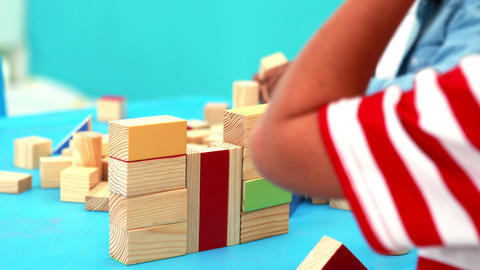 Cute little boys playing with building blocks at t Footage
