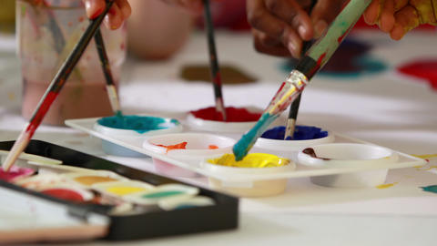 Preschool class painting at table in classroom Footage