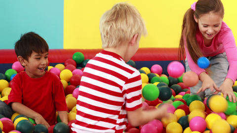 Cute children playing and having fun in the ball p Footage