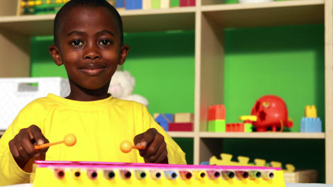 Cute little boy playing xylophone in classroom Footage
