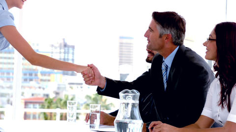Business people on interview panel shaking hands with applicant Footage