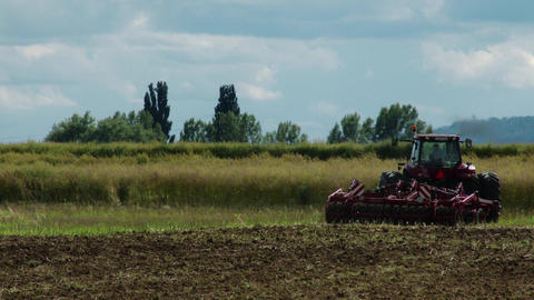 Ploughing Tractor 1 stock footage