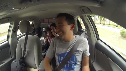 Family enjoying traveling with car through city Footage