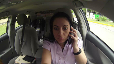 Woman Talking On Mobile Phone In The Car Driving stock footage