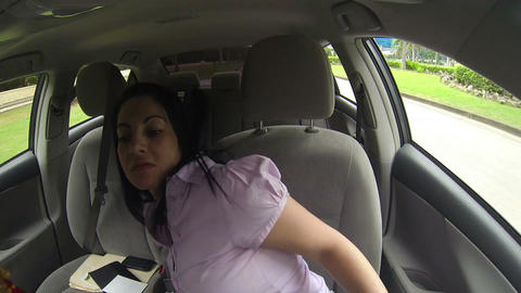 Woman fitting clothes in the car of her shopping Footage