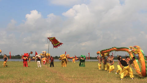 a group of Asian people dance dragon in folk festivals, Asia Live Action