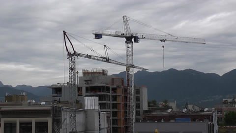 Cranes Working With Mountains In Background stock footage