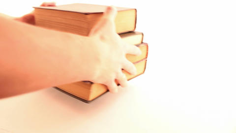 arm puts a book on the table Stock Video Footage
