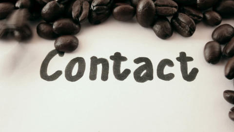 contact. written on white under coffee Stock Video Footage