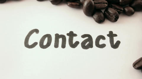 contact. written on white under coffee Footage