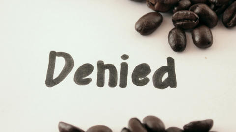 denied. written on white under coffee Stock Video Footage