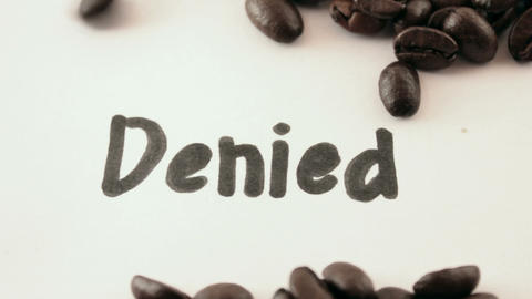 denied. written on white under coffee Footage