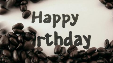 happy birthday. written on white under coffee Stock Video Footage