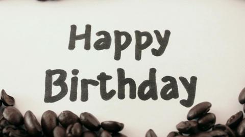happy birthday. written on white under coffee Footage