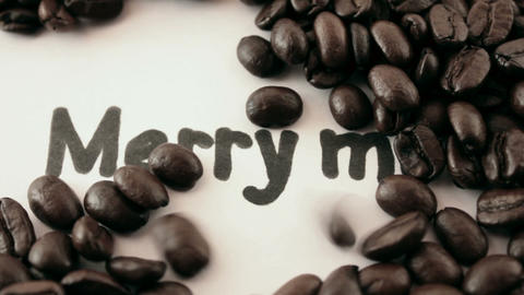 merry me. written on white under coffee Stock Video Footage