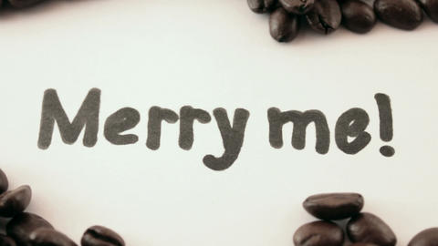 merry me. written on white under coffee Footage