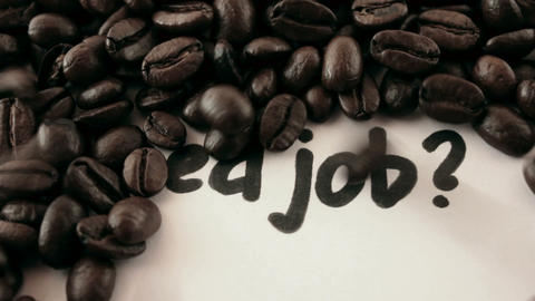 Need job. written on white under coffee Stock Video Footage