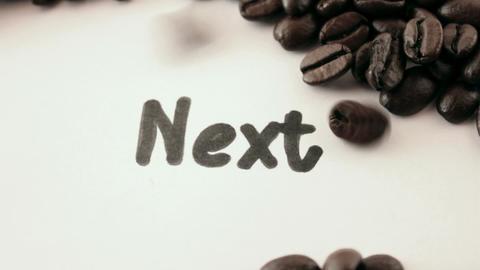 next. written on white under coffee Stock Video Footage