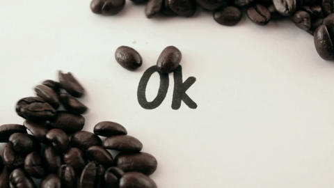 ok. written on white under coffee Stock Video Footage