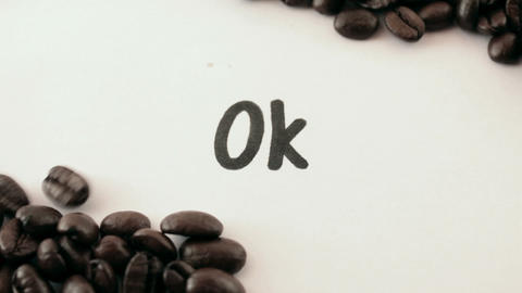 ok. written on white under coffee Footage