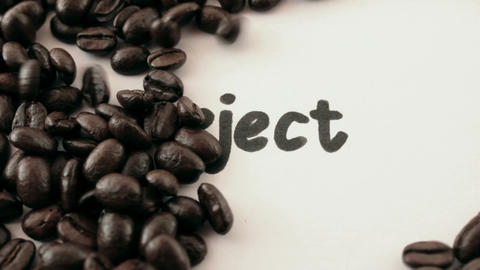 reject. written on white under coffee Stock Video Footage