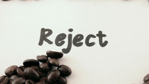 reject. written on white under coffee Footage