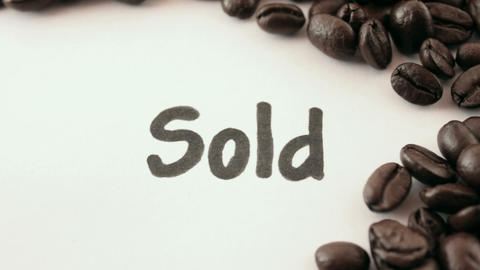 sold. written on white under coffee Footage