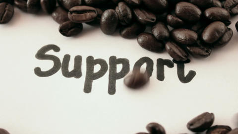 support. written on white under coffee Stock Video Footage