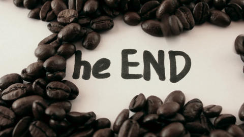 the end. written on white under coffee Stock Video Footage