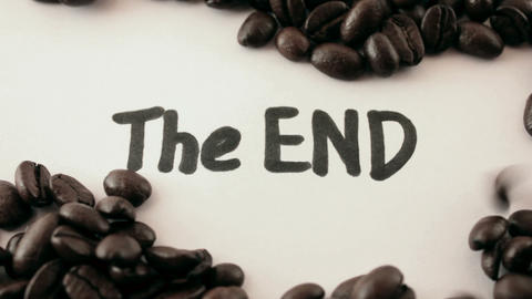the end. written on white under coffee Footage