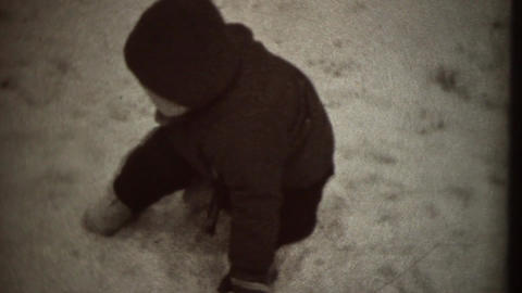 Small boy playing with snow Stock Video Footage
