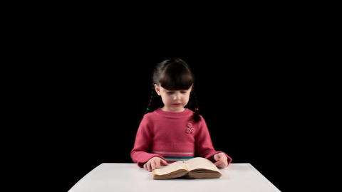 reading girl on black background Stock Video Footage