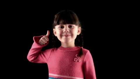satisfied girl on black background Stock Video Footage