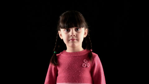 Girl is not looking on black background Stock Video Footage