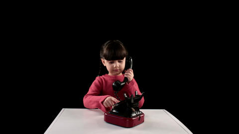 girl telephoned on black background Stock Video Footage
