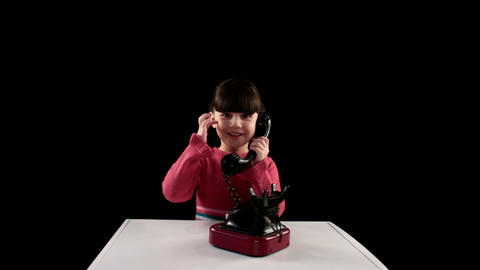 girl telephoned on black background Footage