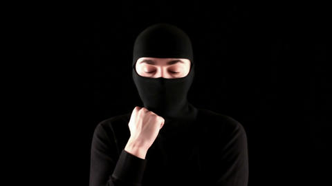 ninja thinks on black background Stock Video Footage