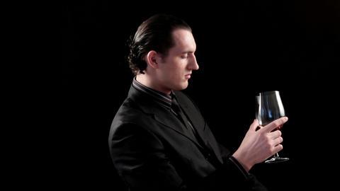 businessman drinking wine on black background Stock Video Footage
