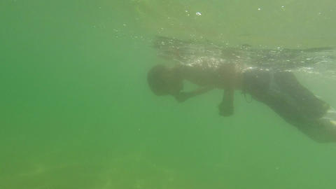 Young Boy Learning To Swim Underwater stock footage