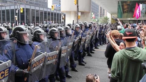 Demonstrators sing political slogans at large poli Footage