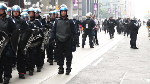 Riot police line marching and forming group in lar Footage