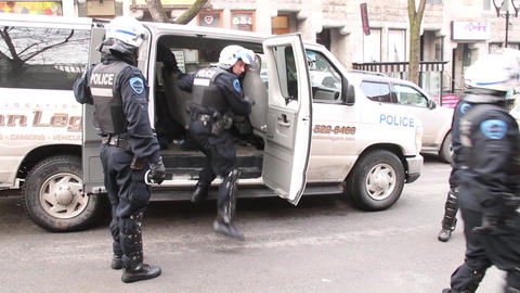 Riot police officers in full gear exit police van Footage