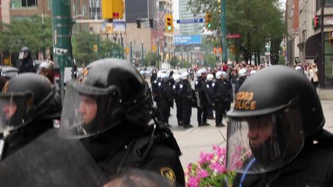 Police troops form defensive line at protest Live Action