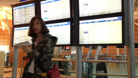 Woman checking the flight inside airport terminal Footage