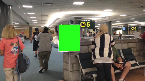 Airport terminal with green ad board Footage