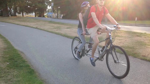 People riding bicycle in the Stanley park Live Action