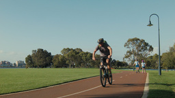 People Exercising Along A Perth Bike Path stock footage