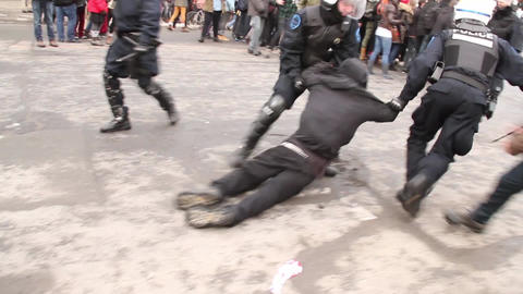 Riot officers charge group of rioters violently -  Footage